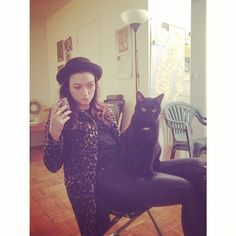 Natasha Negovanlis with an actual black cat. I'll just leave this here...