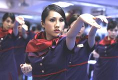 After introducing the idea in Hong Kong Airlines will now be training all its staff members in Wing Chun kung fu to help cultivate a 'strong mind and improve their body quality,' … Learn Wing Chun, Hong Kong Airlines, Airline Cabin Crew, Flight Attendant, Sport, These Girls, Kung Fu, Surabaya, Martial Arts