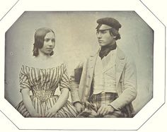 """European quarter plate daguerreotype, horizontal view of a young man and woman taken 1844. Resealed in original octagonal paper mount, inscribed on backing board """"Le 20 Août 1844 / de [Holder?]""""."""