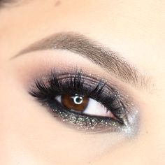 What a fun look for a night out! A little bit smoky and a little bit sparkly, this look by Astrid Lam uses Makeup Geek Signature Eyeshadows in Corrupt, Mocha, Peach Smoothie, and Frappe + Makeup Geek Pigment in Insomnia.