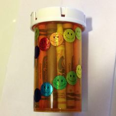 A large pill box recycled to crayon holder.  Fits them perfect for in purses or diaper bags! Holds around 20!