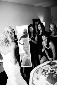 Love this pic. Maids holding up the mirror. Photography By / jamiegrenoughphotography.com, Floral Design By / vandafloral.com