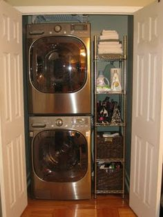 laundry nook-good idea for basement to utilize space instead of one big laundry room.