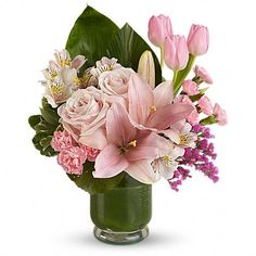 Island Elegance  Take a journey to the tropics with this lush array of pink roses, tulips, lilies and more in a stylish hurricane vase. While you're at it, why not share the journey with a friend?