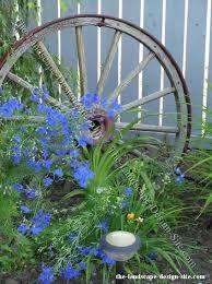 Image result for wagon wheel garden ideas