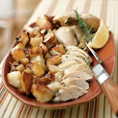 Lemon-Rosemary Roast Chicken with Potatoes ~ Start cooking the whole chicken in the oven by itself, then add lightly-seasoned potato wedges to the roasting pan to finish the cooking process and ensure that the meal comes together perfectly. Carve the bird, dish up the potatoes, and serve with the only side you'll ever need with this recipe–a wedge of lemon.