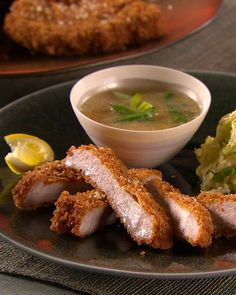 A popular dish in Japan, tonkatsu, or pork cutlets, are typically sliced into bite-size pieces and served with a side of shredded cabbage.