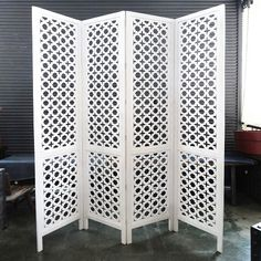 A beautiful and intricately carved wood Jali screen/room divider at MIX. This is like the one in the photo with the mid-century modern, white upholstered chair. Love it. Get the look at MIX today! // MIXFurniture.com