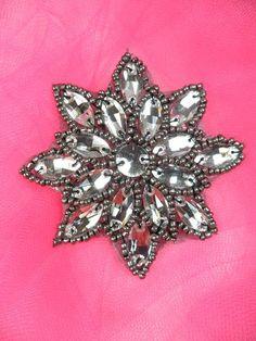 Gunmetal Crystal Rhinestone Applique Jewel Snowflake Patch Size: 3 x 3  Lovely Gunmetal Smoke Black Snowflake applique.  Sewn on Flat Back Clear