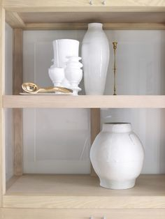 Piet Boon Styling by Karin Meyn   Beautiful wooden cabinet with white delicate vases