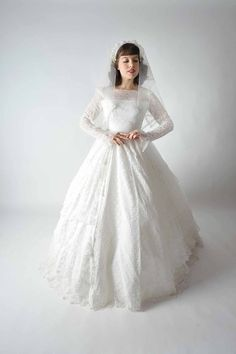 1950's Lace Bridal Gown with Lace Long Sleeves and a Ball-Gown Skirt.