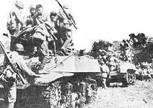 Chinese troops on Stuart tanks