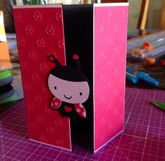 CREATE A CRITTER: Lady bug party invitation (cut out ladybug at 2.5) and used Cuttlebug (final cut) pg 66