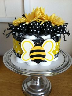 A modern and trendy yellow, black and white polka dot bumblebee mini diaper cake... perfect for a baby girl! This mini diaper cake makes a