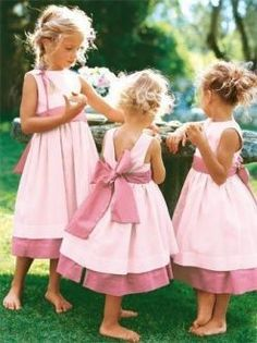 Little bridesmaid dress   (Maybe in white with a lavender bow)