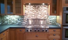 Paper stone counter tops, fir cabinets, tile back splash with stainless steel appliances. Castile Construction, Inc. Eugene, Oregon.