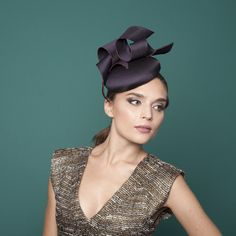 Flaine - Medium Cocktail Hat with Ribbons Silk covered base with silk ribbon trim and embroidered stitching detail.    A very fetching hat, ideal for a winter wedding.  Sits on the right hand side of the head and secured by an elastic that sits under the hair.