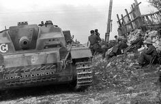 German armor and infantry A StuG III Ausf. F/8 (Sturmgeschütz III Ausführung F/8) assault gun and German infantry, resting somewhere in Russia.