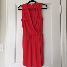 Red Rachel Roy Dress  Super classy red Rachel Roy dress. Deep v neckline with slit on the side. Bought for professional work attire but it has just been sitting in my closet! Super classy and professional! Size medium but the material is stretchy and a little thicker. No tags on it but great condition!  Rachel Roy Dresses Mini