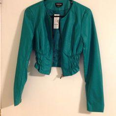 BEBE leather like jacket XS turquoise green NWT BEBE synthetic leather Turquoise green cropped XS. Brand new bebe Jackets & Coats