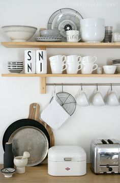 organize. The rooms have awful metal open cabinets with mismatched dishes. Remove cabinets. Add floating wide shelves. Sole clean dishes