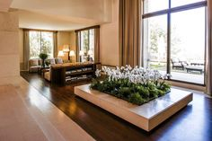 The large indoor area for planted flowers are meant to suggest a traditional Arab courtyard.