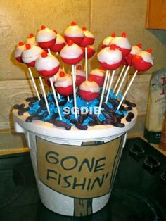 I like the cake pops as Bobbers maybe a nice round cake with blue icing to be the water. Maybe some swedish fish along the bottom. Tylers bday