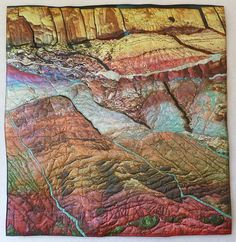 Painted Canyons map art quilt by Charlotte Ziebarth.. A combination of photography, digital art alterations, and layering and stitching on cloth, allows the artist to tell a multi-layered story of real and imagined landscapes.