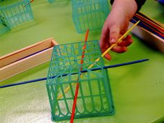 As children thread the sticks through these strawberry baskets, they increase their fine motor skills in a fun way.