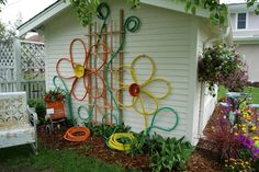 old hoses and bundt pans used to create outdoor art