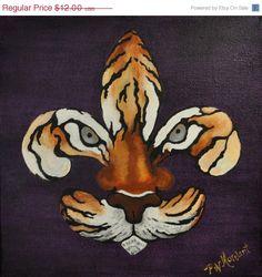 fleur de tigre....we love our Tiger's in Louisiana. :-) LSU TIGERS - LSU TIGERS colors purple & gold - Louisiana State University