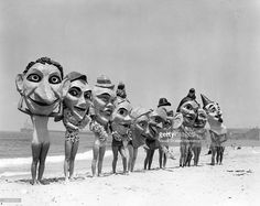 Group of women on the beach preparing for the Annual Venice Mardi Gras and Carnival wearing paper mache masks, Venice, California, early to mid 20th century. (Photo by Visual Studies Workshop/Getty Images)