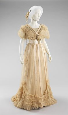 "Wedding Dress, Mme. Jeanne Paquin (French, 1869–1936) for the House of Paquin (French, 1891–1956): 1910, French, silk, cotton, beads. Marking: Woven in pink on ivory petersham: ""Paquin/Paris/ 3. Rue de la Paix/London/ 39, Dover Street"" Handwritten on back of petersham: ""M. Constable/blanc"""