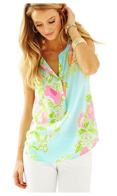 acca213879ca2 The Lilly Pulitzer Sleeveless Stacey top in Pink Lemonade is a version of  our very popular Stacey top. This sleeveless printed silk top has a hidden  bottom ...