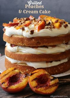 Grilled Peaches & Cream Cake.  This gorgeous summer dessert, piled three layers high with homemade yellow cake, a cool and creamy, pudding-infused frosting, grilled in-season peaches, and chopped pecans, is sure to wow!  I mean, seriously, it's out-of-this-world beautiful!  Just wait 'til you taste it!