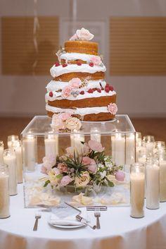 cake stand, photo by Suzuran Photography http://ruffledblog.com/new-years-eve-cleveland-wedding #cakes #weddingcake #nakedcake