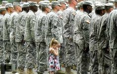 """Little girl can't let go of daddy as he prepares to leave for Iraq""  <3 emotional."