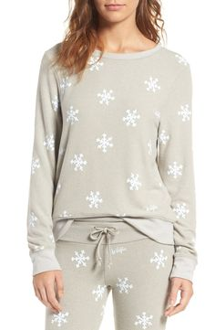 When the weather outside is frightful, stay comfy-cozy in this slouchy, ultrasoft pullover printed with pretty snowflakes in a nod to this festive time of year.