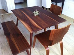 Walnut dining table, mid century modern featuring tapered wood legs.