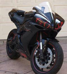 I dig the headlights. Black and red just like my bike.