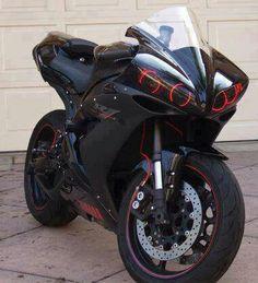 I dig the headlights. Black and red just like my bike.