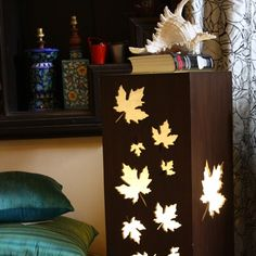 Maple leaf table with glow-stenciled leaf cuts. Lovely.