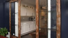 Incorporating barn doors is a popular aspect of rustic design. Scaled-down versions can disguise a television screen or bar when it's not in use. You can use full-size sliding barn doors as pantry or closet doors, room dividers or an alternative to pocket doors. Want to feature an interior barn door in your home décor? Here's what you need to know.