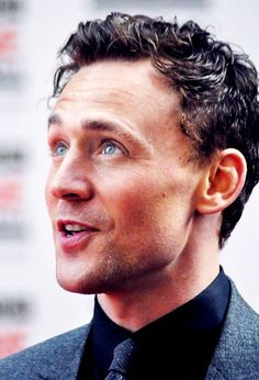 Tom Hiddleston. I like this pic because you can see his natural hair color coming out. Which I happen to like, very much.