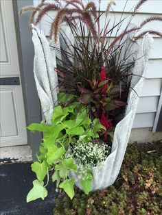 astonishing cement flower pots. Concrete dipped towel made into flower planter spray painted to glow white  at night How Make Cement Draped Planters and Gardens