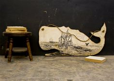 Nautical Themed Print on Large Wood Whale Hangs with Waxed Rope via Etsy.