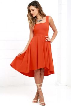 You obviously have some style momentum, so make sure the Course of Action Orange High-Low Dress keeps the ball rolling! Wide shoulder straps meet a squared-off neckline and fitted waist. A full knit skirt descends, forming a lovely high-low silhouette. Hidden back zipper.