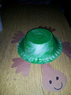 Create this fun turtle craft with just a bowl some green paint, and green construction paper!