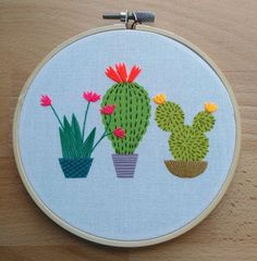 Cactus embroidery hoop art. Colourful contemporary hand stitched design