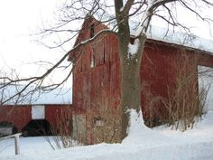old red barn in snow